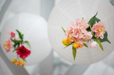 Light globe wedding reception decorations with flowers at TerrAdorna
