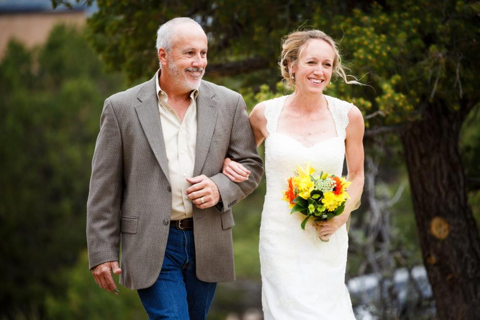 Allison walks in to their DIY Colorado Destination Wedding