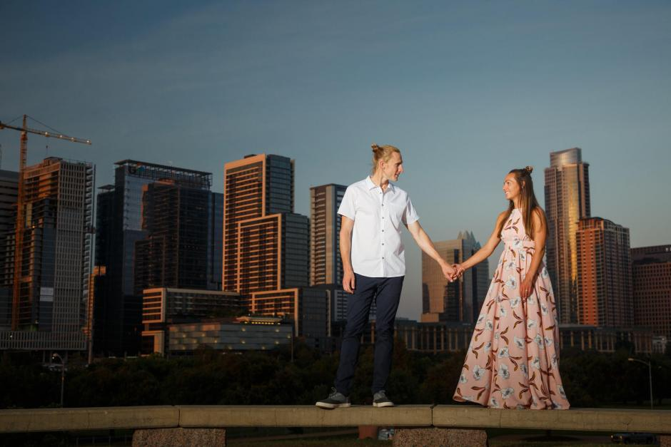 Carl and Sarah Sunset on the Austin Water Front with Downtown Austin Behind them Engagement Photos - Downtown Austin Engagement