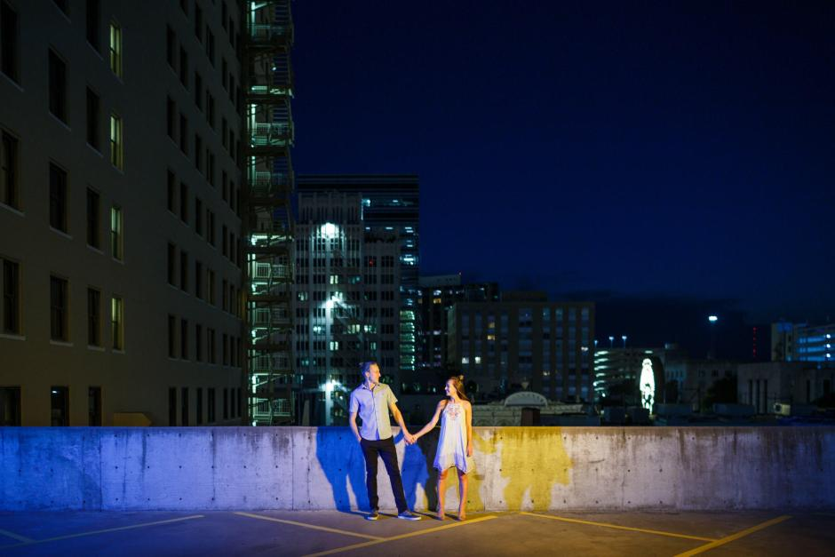 Carl and Sarah Engagement Photos at Republic Square with a view of Downtown Austin at Night.