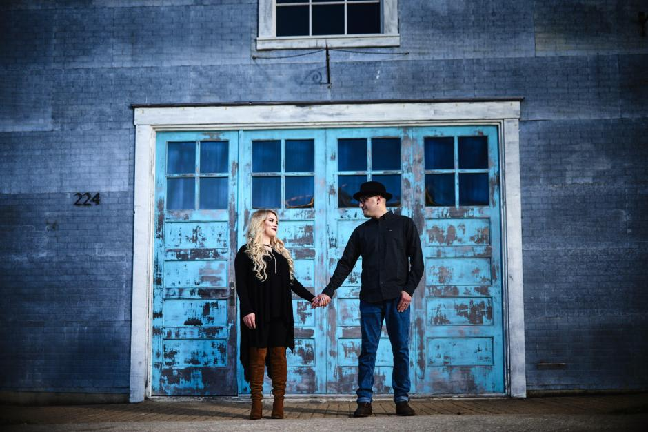 Downtown Georgetown Engagement photo against cool blue doors at Union on 8th