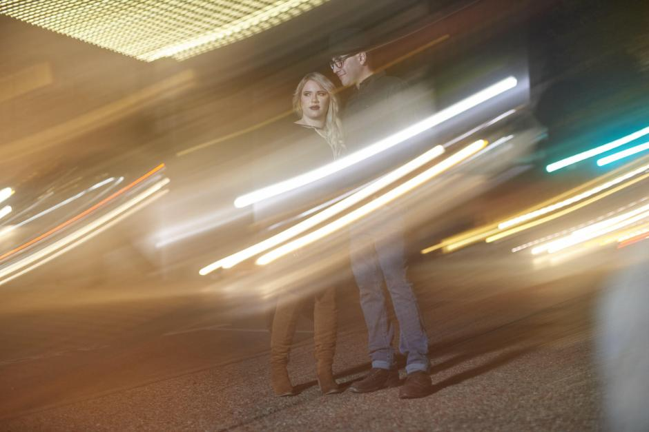 A shutter drag engagement photo in downtown Georgetown.