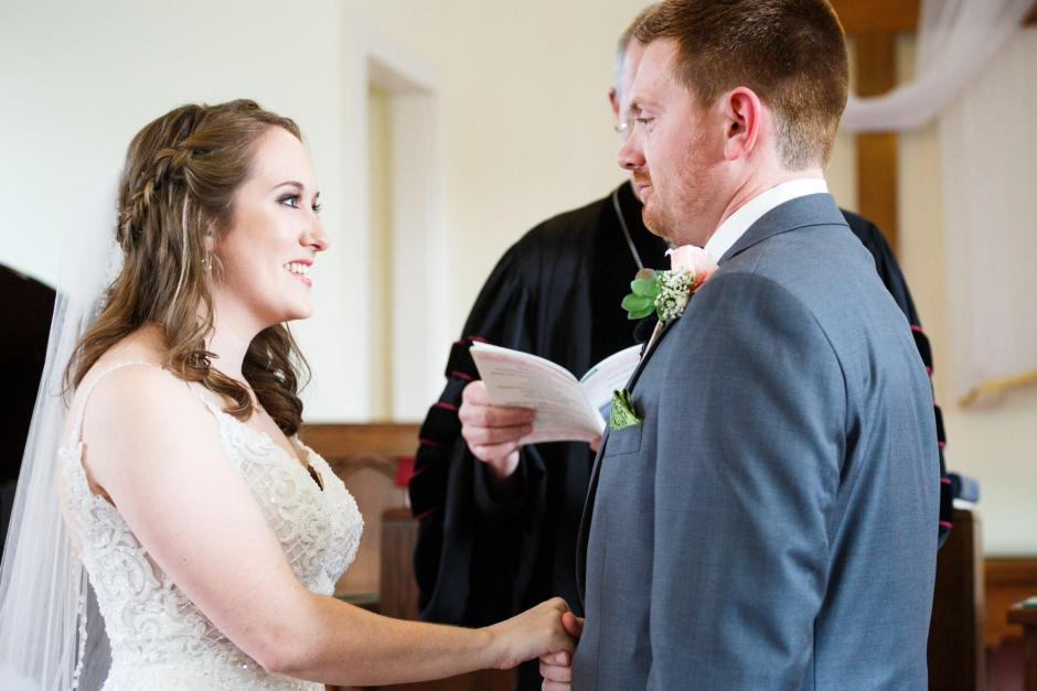 Joshua and Brittany Wedding - Bride and Groom exchanging vows at Hyde Park Presbyterian Church in Austin, TX.