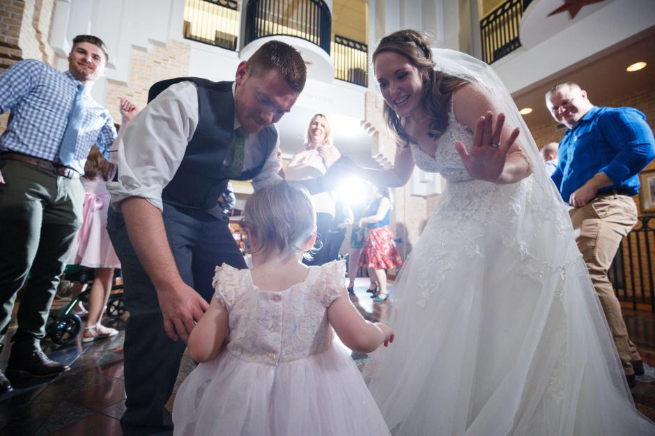 Joshua and Brittany Wedding - Bride and groom dancing with the cute flower girl at their UT Alumni Center wedding reception. Etter-Harbin Alumni Center.
