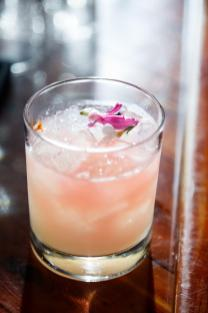 Mike and Kathie flower inspired drink at their ATX wedding.