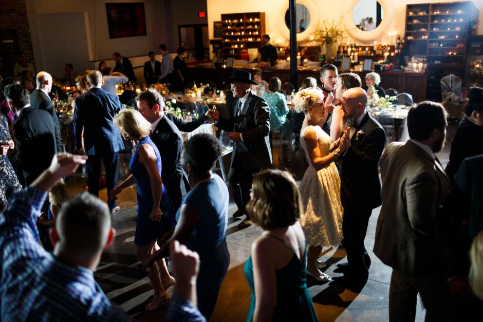Mike and Kathie dance with other guests at their Palm Door wedding reception.