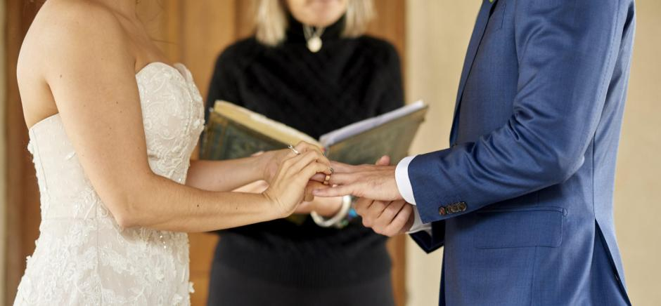 The bride and groom exchange rings during their Chapel Dulcinea elopement wedding ceremony.