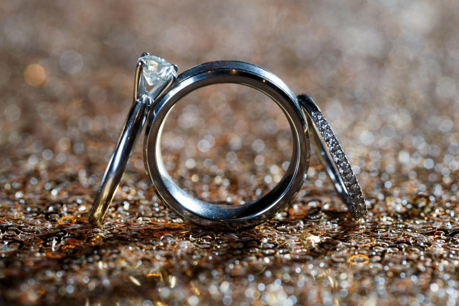 Detail shot of wedding rings and engagement rings.