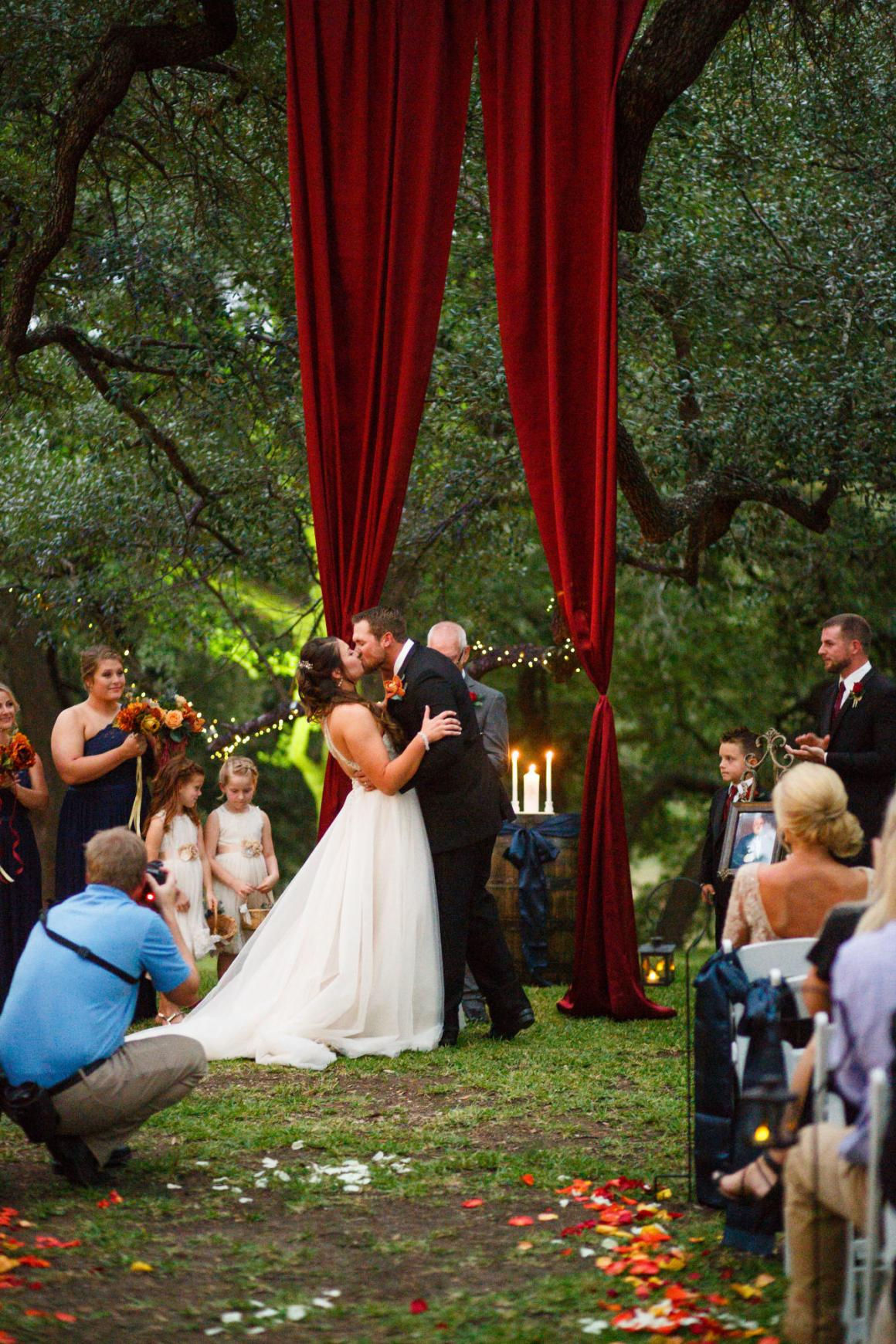 Bride and Groom's first kiss at Cathedral Oaks.