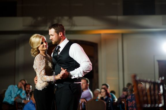 Groom dances with his mother at their Cathedral Oaks wedding in Belton, Tx.