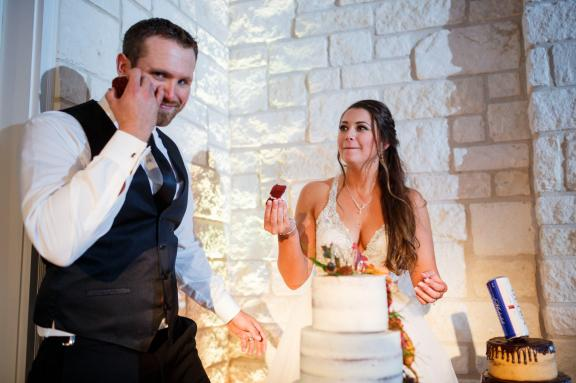 Groom looks worried before cake cutting at Cathedral Oaks Wedding Reception.