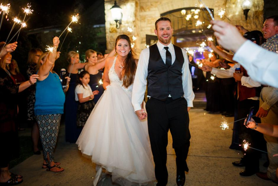 Bride and groom have a sparkler exit after their cathedral oaks wedding reception.