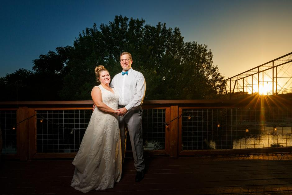 Bride and groom pose for sunset portraits along the Guadalupe river outside The River Venue in New Braunfels, Tx.