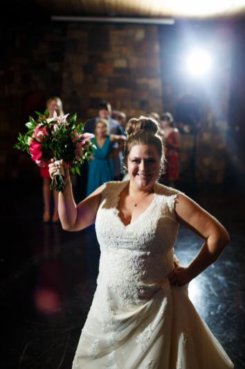 Bride prepares to toss the bouquet at her The River Venue wedding reception in New Braunfels TX.