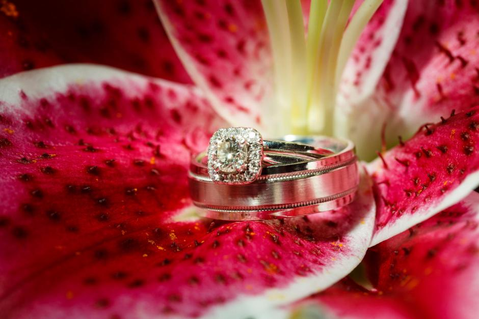 Bride and Groom's wedding rings on a perfect Lilly at The River Venue in New Braunfels, Texas.