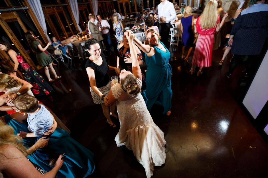 Bride dances with her friends at her wedding reception in New Braunfels Texas.