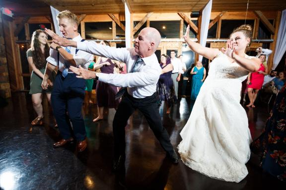 Bride parties with her father at her wedding reception in New Braunfels Texas.