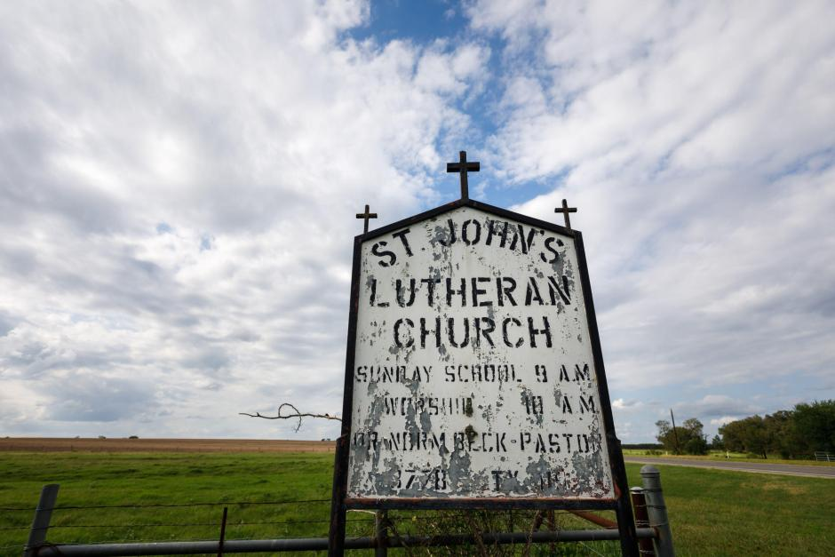 Antique sign for St John's Lutheran Church in Denhawken, Tx.