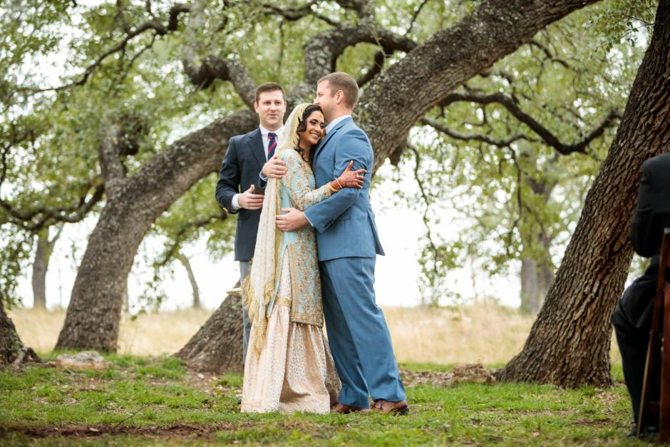 Bride and Groom have their first hug - Heart of Texas Ranch Wedding in Marble Falls Texas - Indian-Christian Fusion Wedding