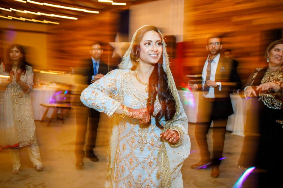 Bride dances during her wedding at Heart of Texas Ranch Wedding in Marble Falls Texas - Indian-Christian Fusion Wedding