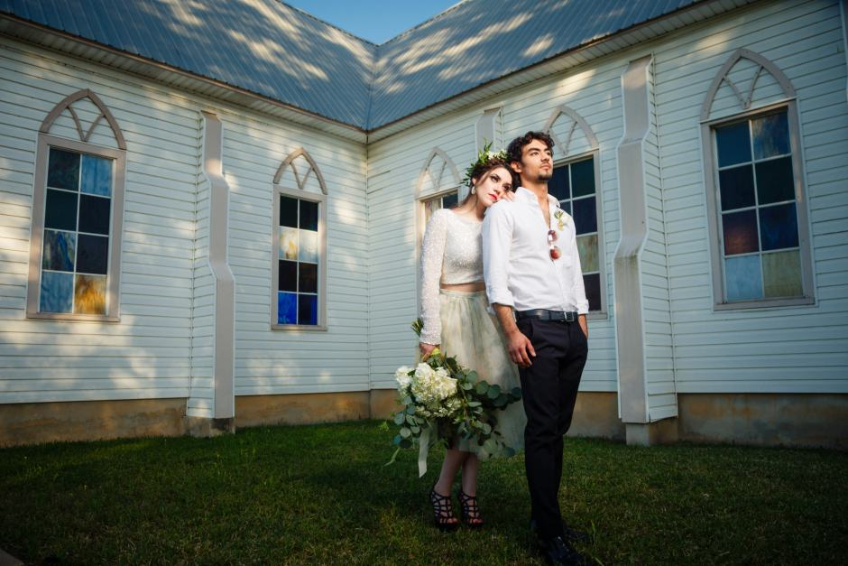 Austin Wedding Style - Styled Wedding Shoot - Wedding portraits in front of small country church with nice stained glass near Manor.