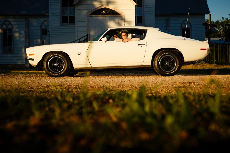 Austin Wedding Styled - Styled Elopement - Bride drives the couples classic camaro get-away car.