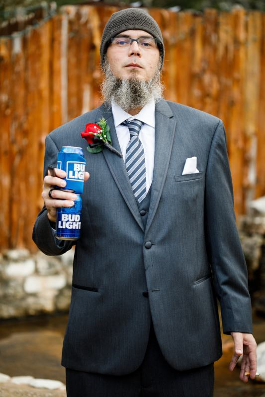 Fun groom's man with a couple of bud lights at a Buda Wedding at Ruby Ranch and Lodge near Austin, TX.