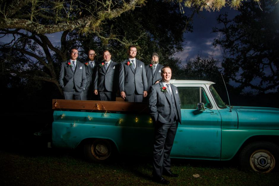 The Groom and Groomsmen on a cool old truck at Ruby Ranch and Lodge in Buda, TX.