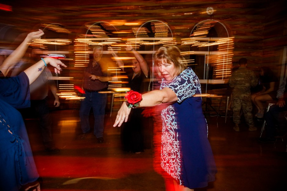 Guests party at a Ruby Ranch Lodge wedding reception in Buda, Texas.