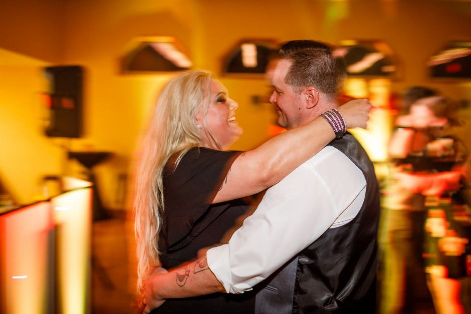 The bride and groom dance together during their Buda Texas wedding reception at Ruby Ranch Lodge.