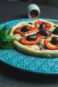 delicious pizza served on ceramic dish with ornament
