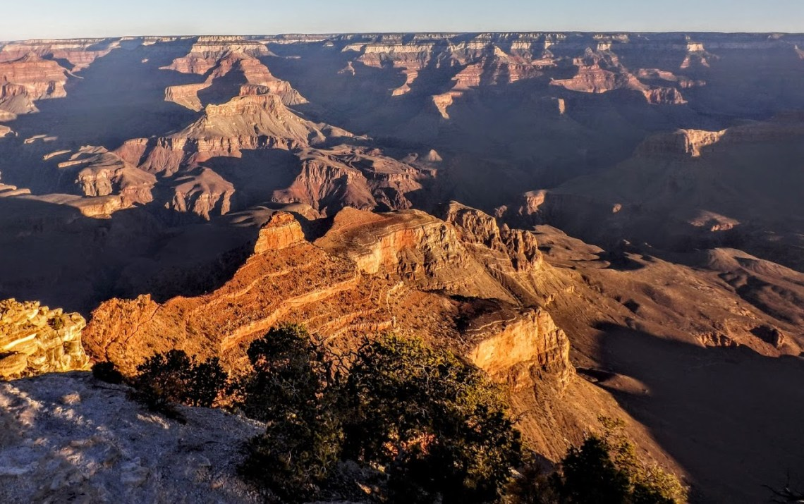 Fall sunrise casts shadows across the Grand Canyon