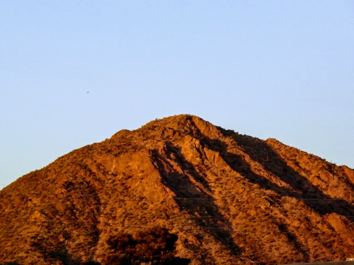 Camelback Mountain Camelback Mountain with a red hue from the sunset