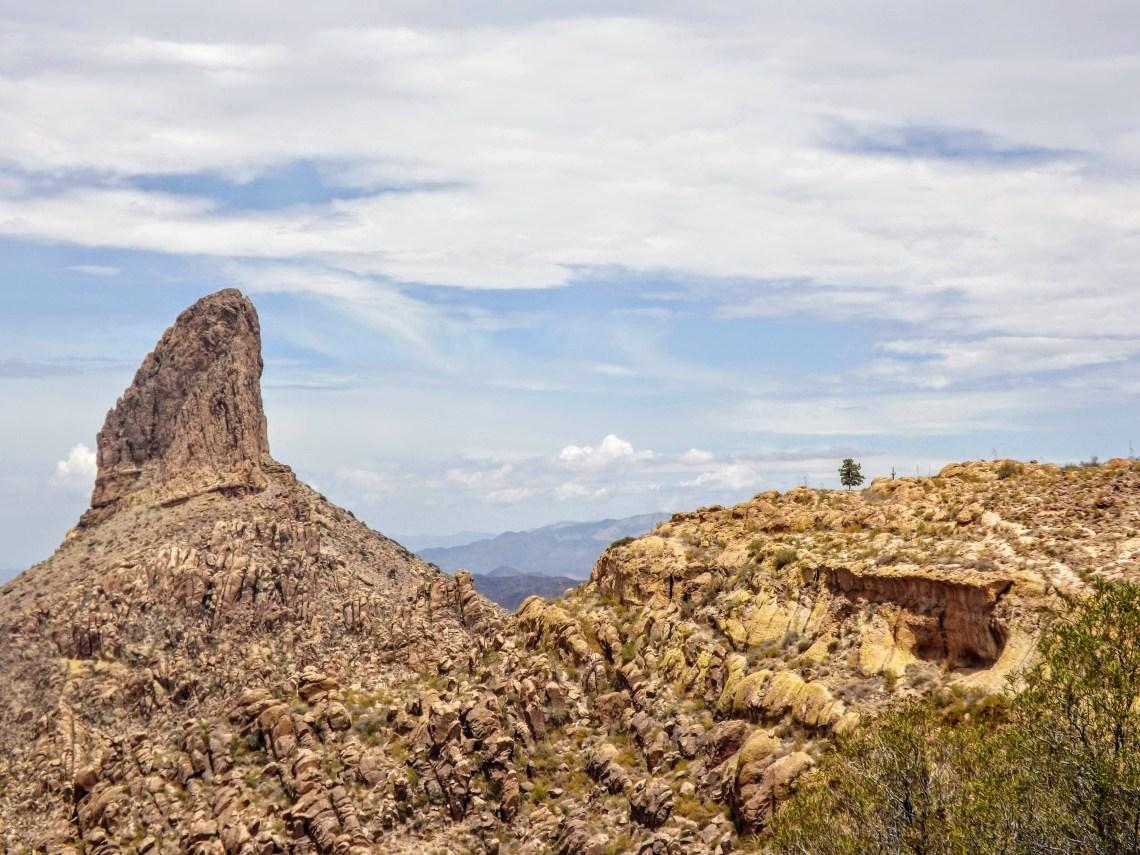 Weavers Needle rock formation rises above surrounding landscape