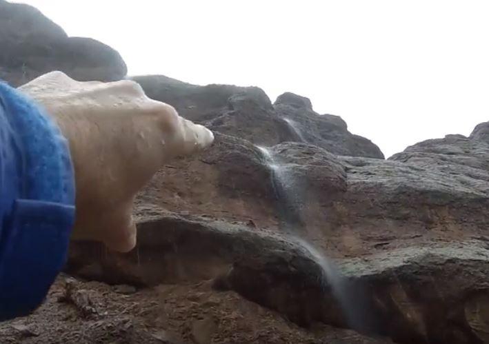 waterfall cascades down a rock face