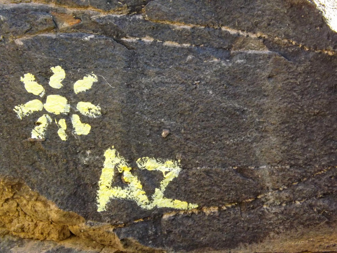 Rock with a sun image and AZ painted on it