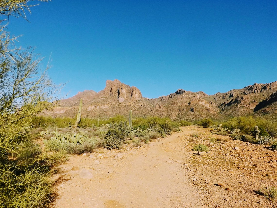 Desert trail heading heading toward mountain range