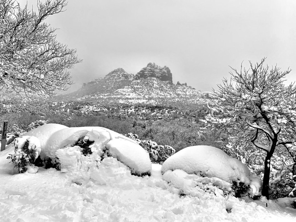Snow blankets the rugged landscape of Sedona, AZ