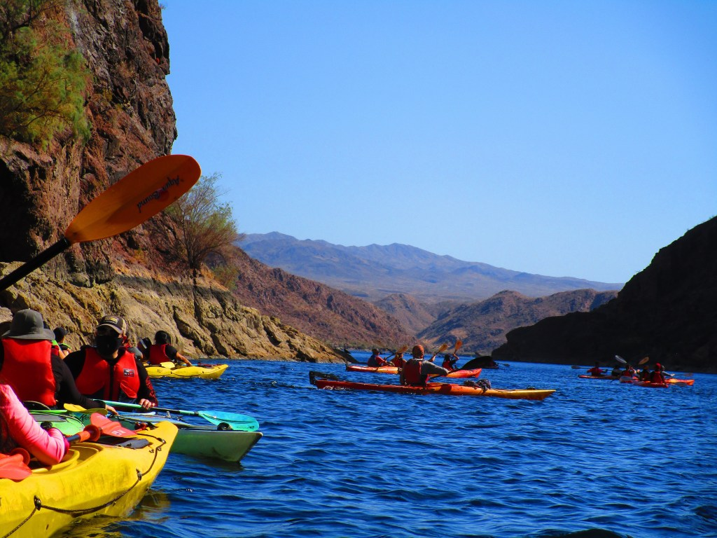 Several people kayaking on the Colorado River