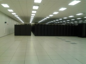 A broad view, showing the cooling units (left), and the compute cabinets (right); housing both amd cpus and gpus, totalling 20k+ nodes