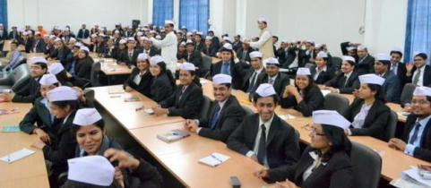 Top management graduates learning business management from the Dabbawalas. Photo courtesy: 'The Hindu' online newspaper.