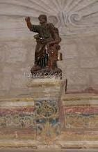 a statue of St Matthew in the old chapel