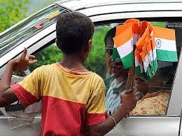 Little boy selling Indian flag at Mumbai's traffic signal.
