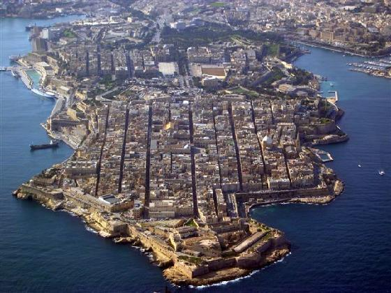 An aerial view of Valletta, on an isthmus and clearly showing the parallel grid streets.