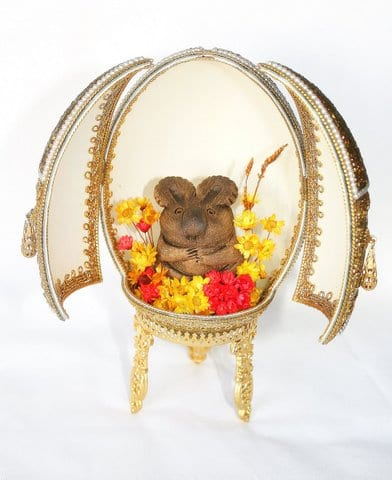 A two-door-cut- hinged Emu Egg open with Koala and flowers Hand decorated by Patricia Newell-Dunkley