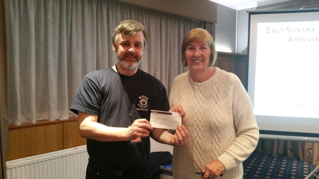 Trevor being given a cheque from CSMA