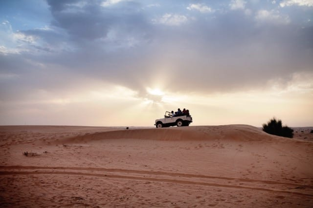 Adventure_Desert Safari_Car on dune sunset