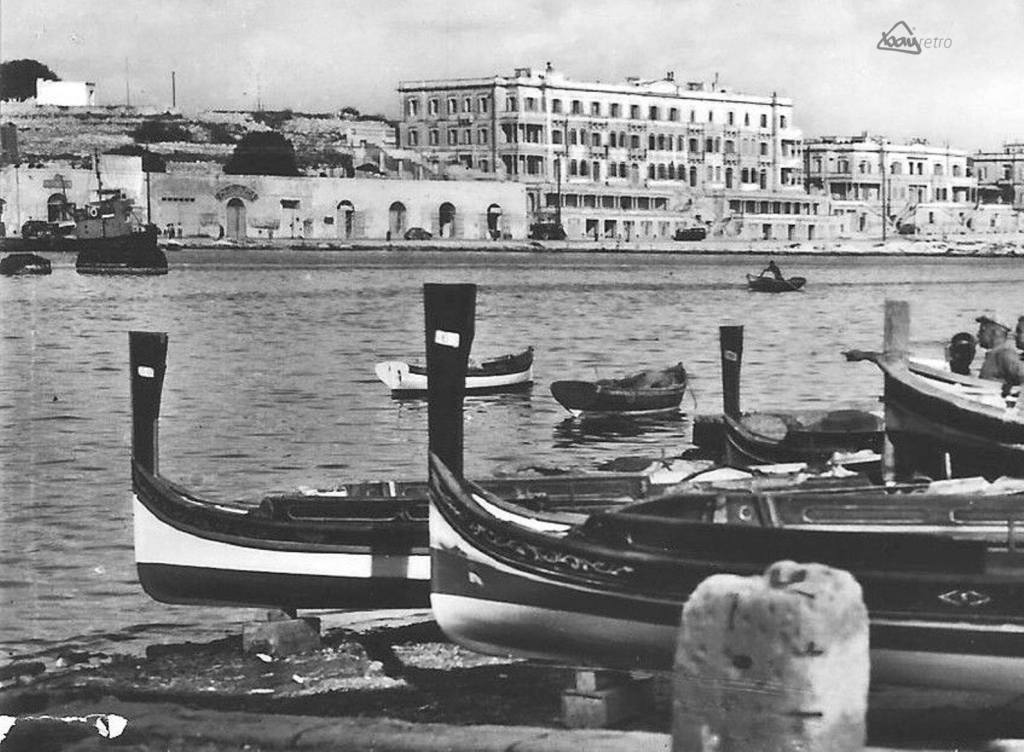 Driving along the Msida Seafront past the submarine depot with the apartments for RN Wrens in the background.