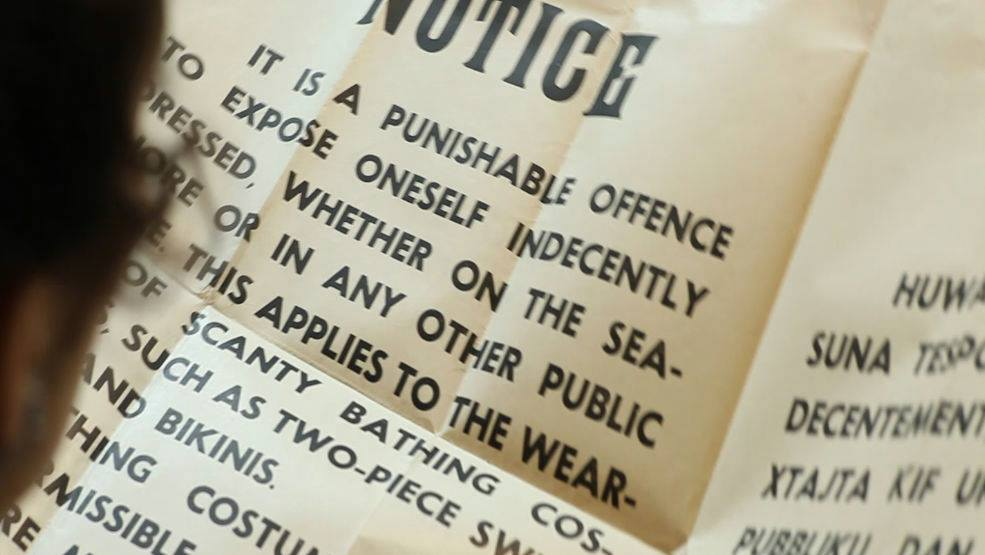 Public-notices-posted-in-all-swimming-areas-strictly-banning-the-wearing-of-bikinis-enforced-by-regular-Police-patrols.