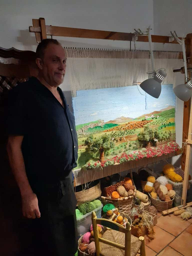 Pic Bohemia Restaurant manager Pedro Trillo with his tapestry work